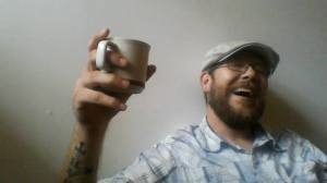 Shaun Crump, taking a moment to enjoy a well deserved cup of coffee.